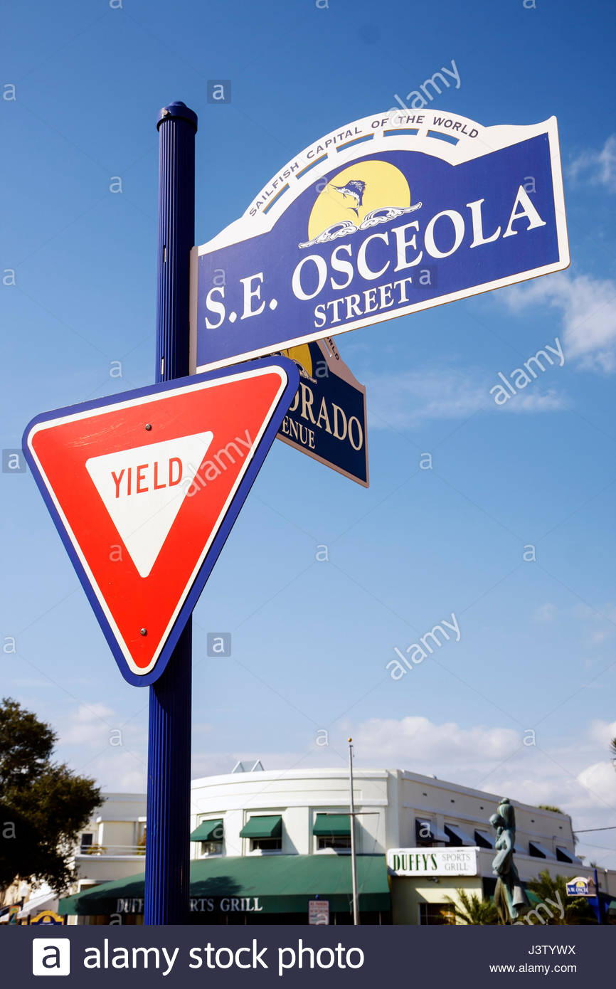 Stuart Florida Osceola Street street sign Osceola Street yield sign triangle Sailfish Capital - Stock Image
