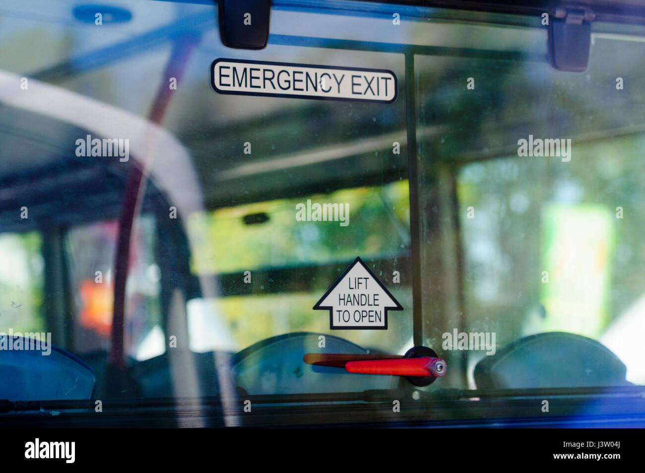 Handle on the emergency exit rear window of a double decker bus. - Stock Image