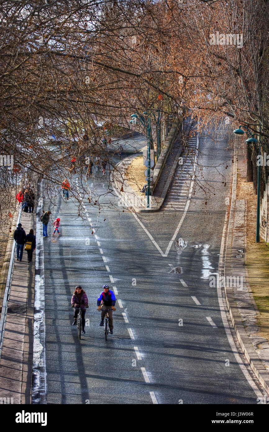 Cyclists on crossroad of Pont Marie and Voie Georges Pompidou. Paris. France - Stock Image