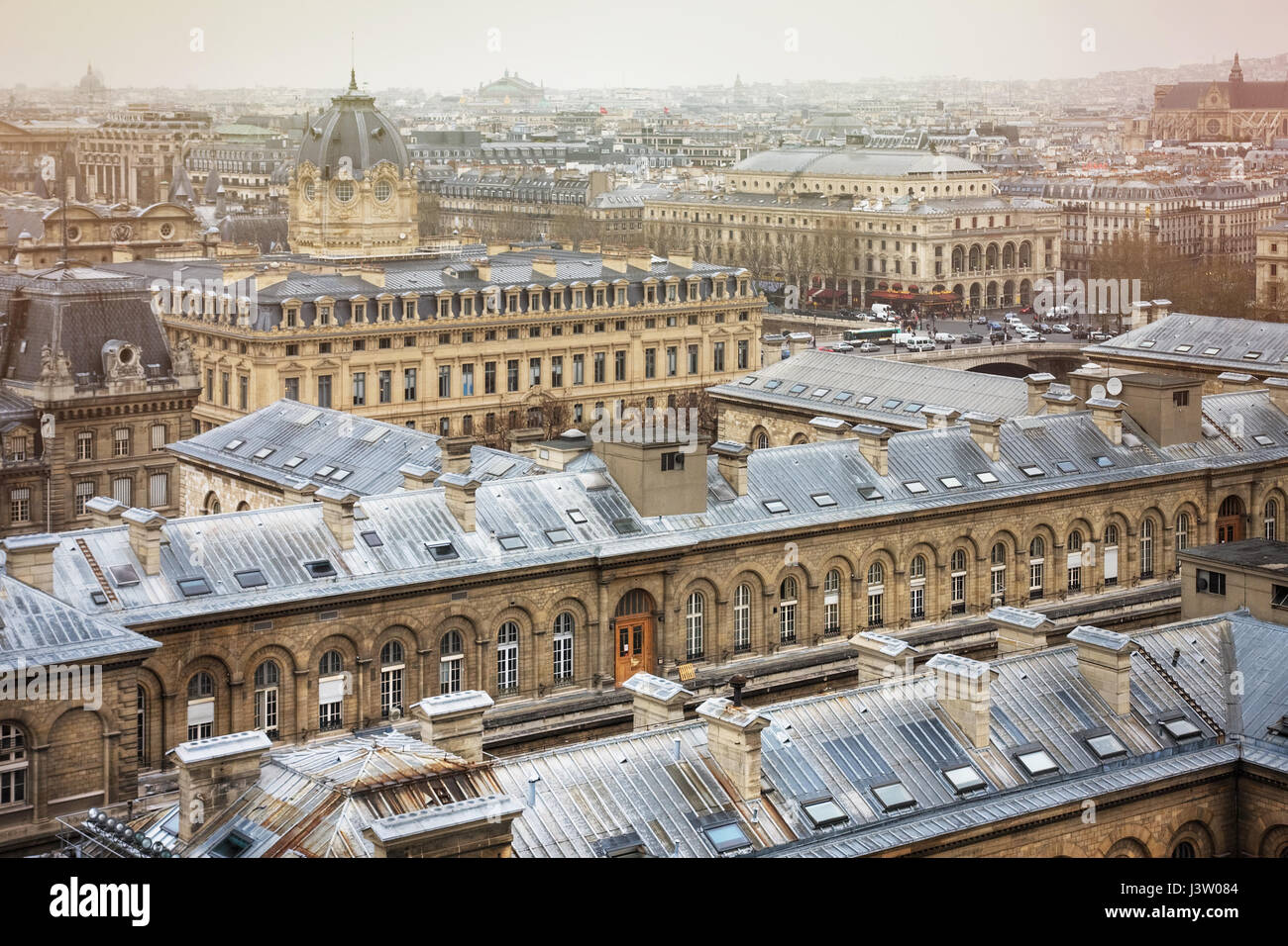 Spectacular image of Paris roofs from Cathedral Notre-Dame de Paris. Hopital Hotel-Dieu, above and Registry of the - Stock Image