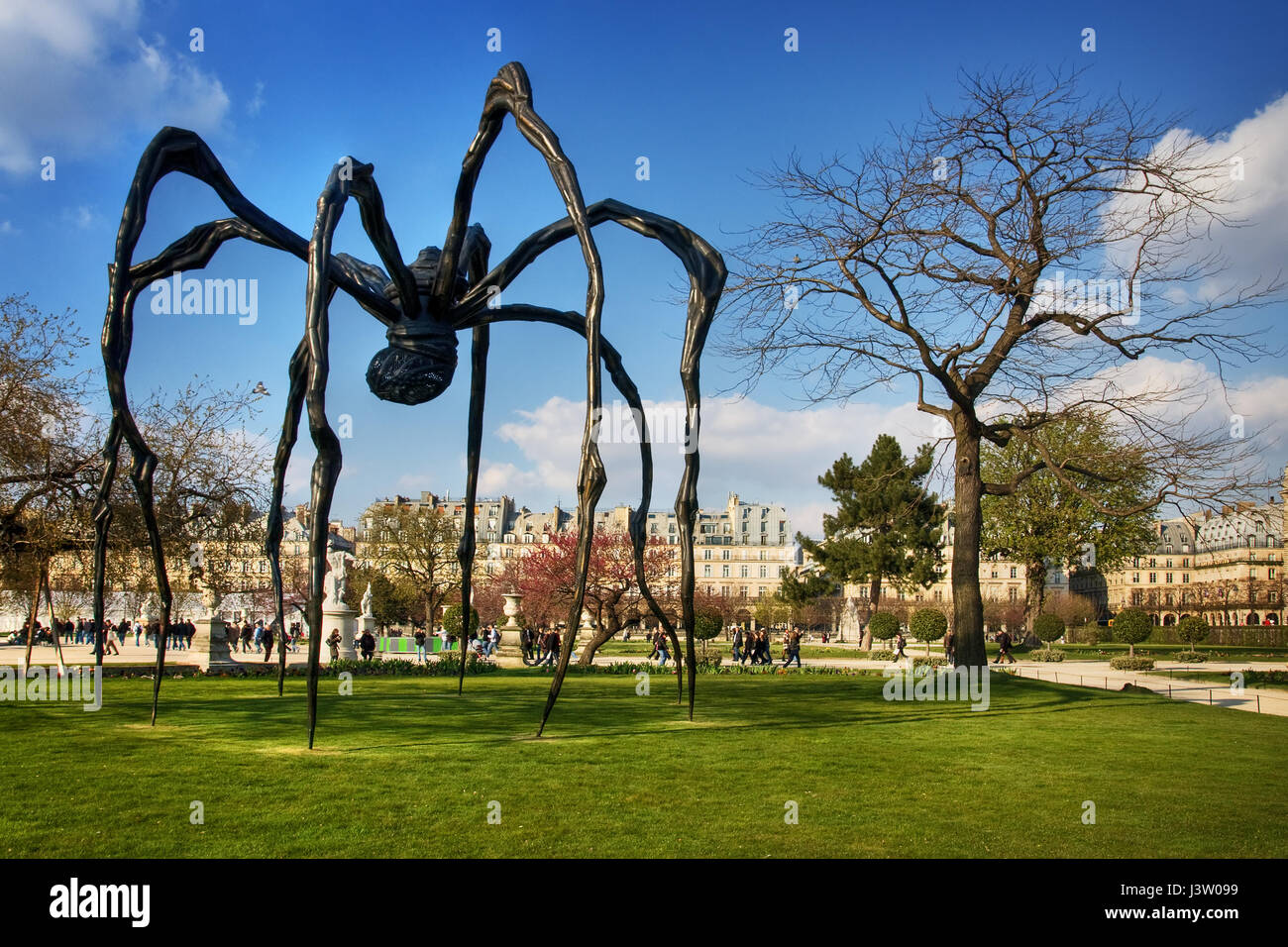 The Maman, a gigantic spider sculpture by Louise Bourgeois, is standing outside at Grand Bassin Rond which is located - Stock Image