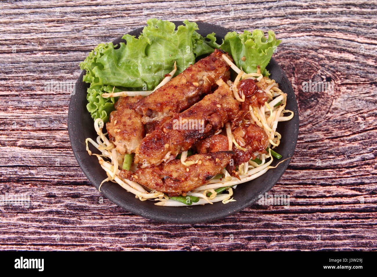 Chinese food ,Fried steamed grated radish with dried shrimp , shallot and bean sprouts call Khanom Phak Kad in Thai - Stock Image