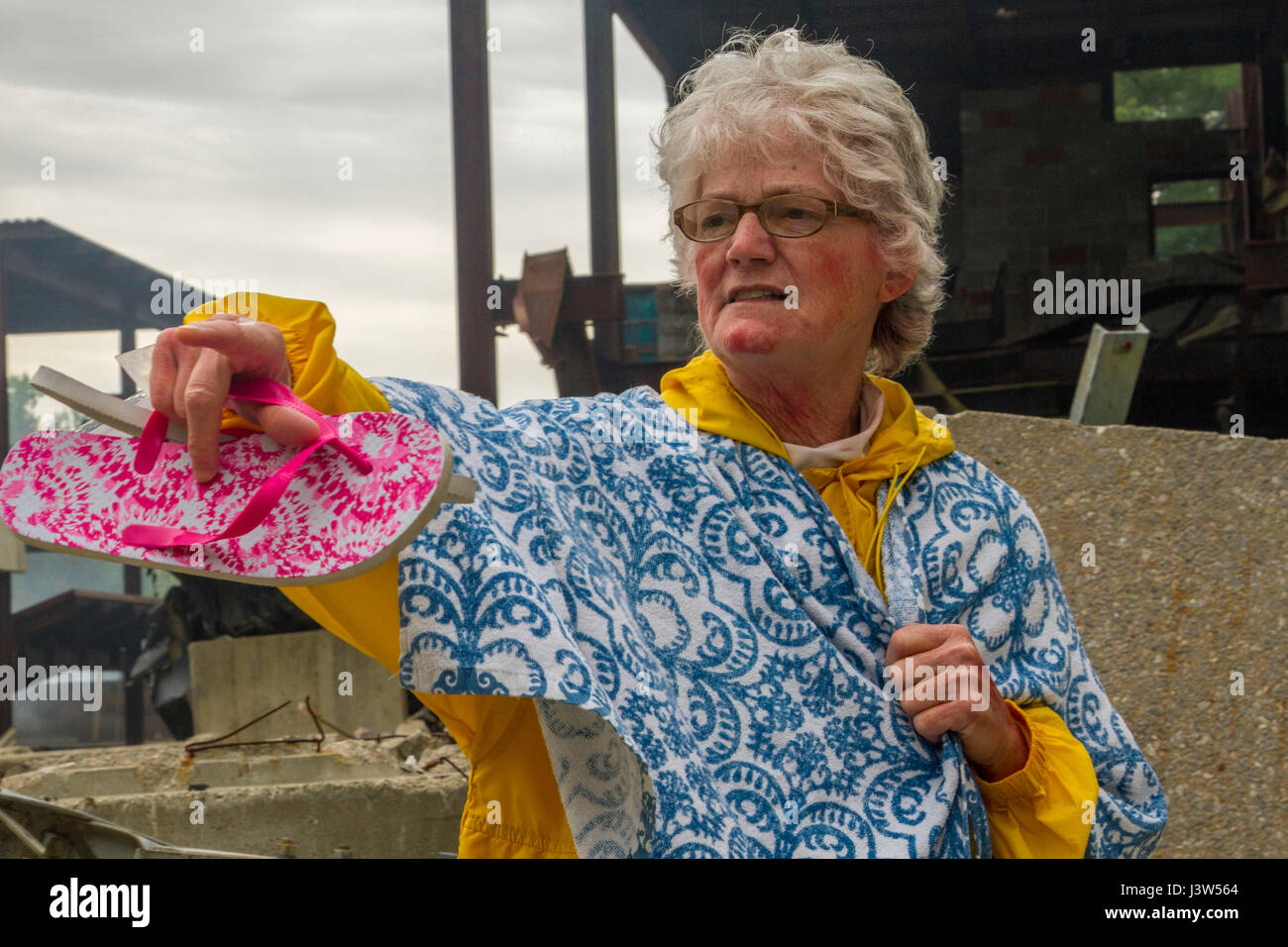 Civilian role player Rita Hyden of North Vernon, Ind., directs emergency responders to others requiring medical - Stock Image