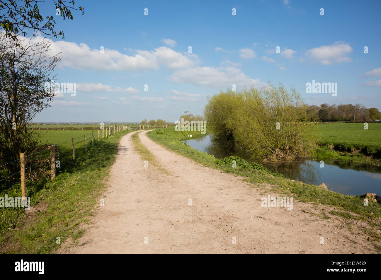 River Parrett and towpath cut through farmland in Somerset England - Stock Image