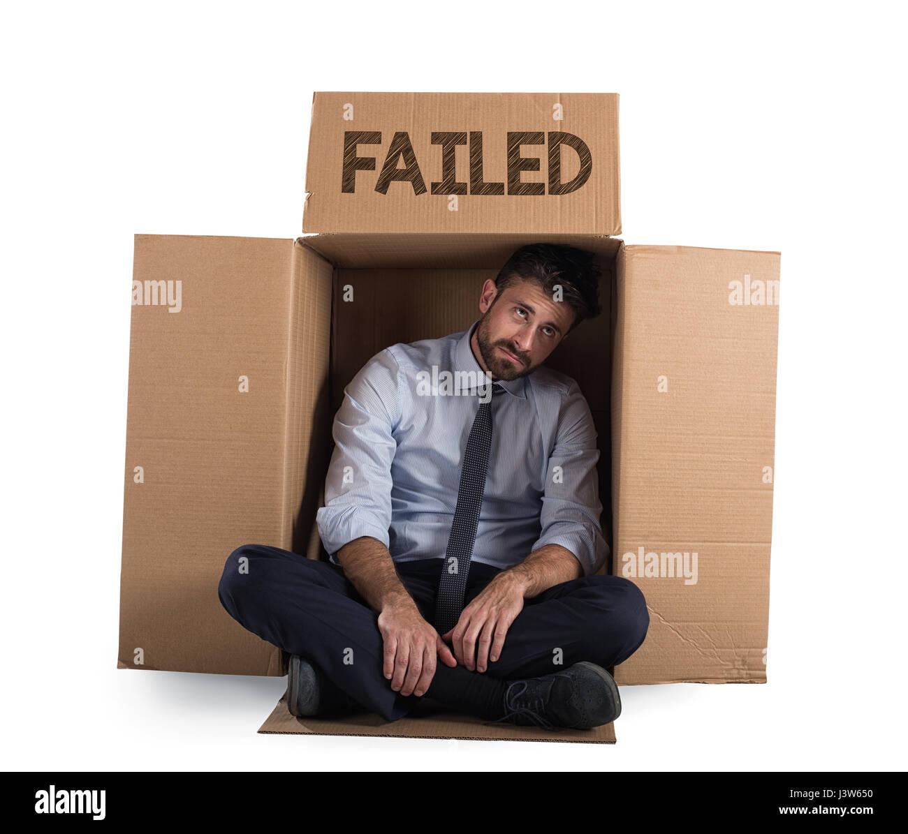 Failed businessman on the street - Stock Image