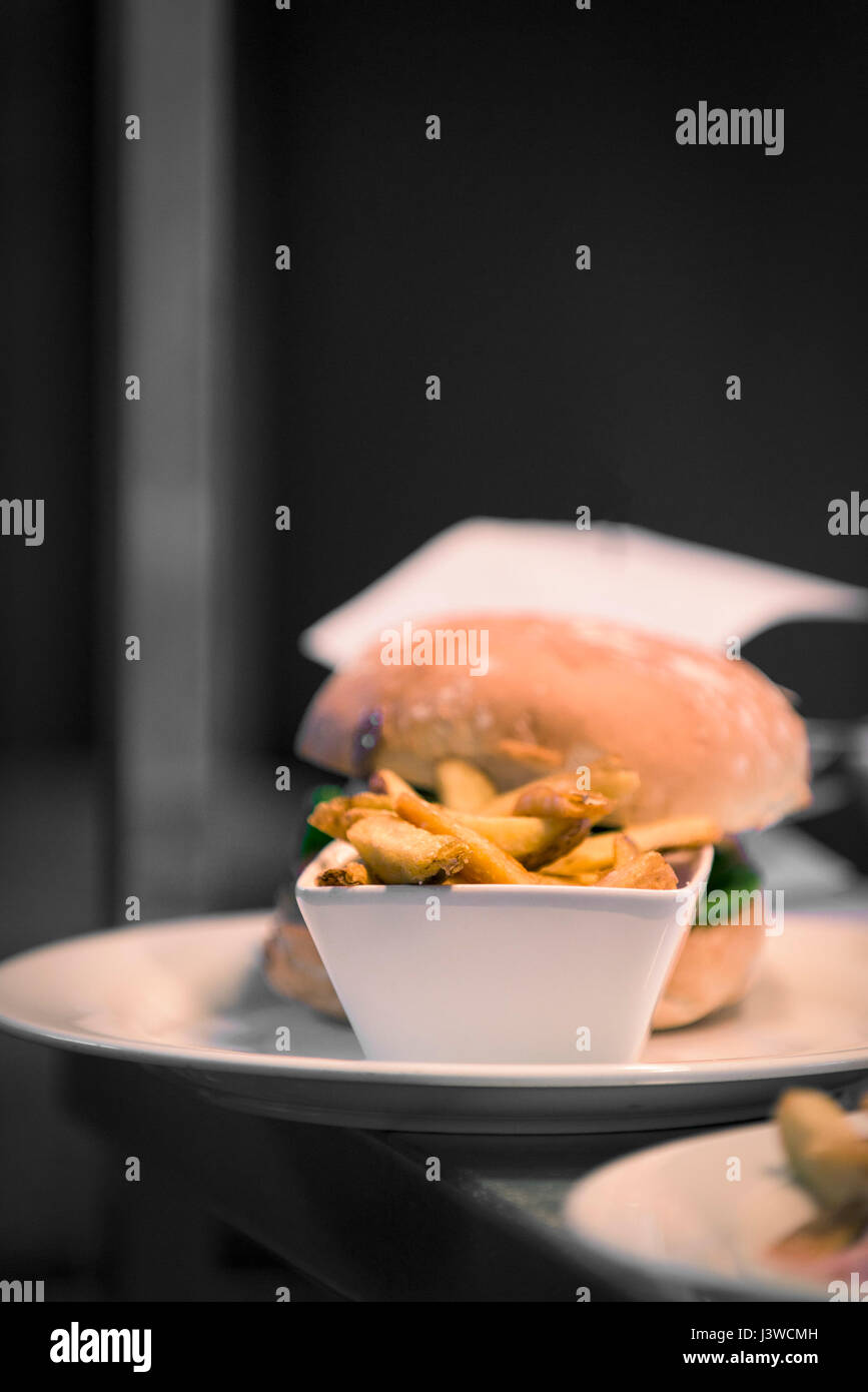 Burger and chips French fries Food Meal Waiting to be served Restaurant Food industry - Stock Image