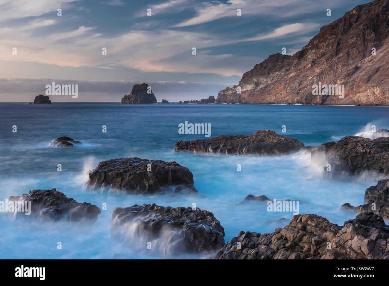 Columnar jointed lavas and the sea stacks of Roques de Salmor, Las Puntas, El Hierro, Canary Islands - Stock Image