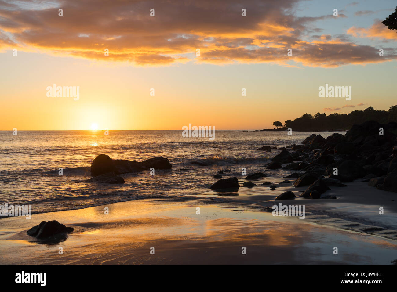 Beautiful sunset at Tamarin, seen from the beach of the Tamarina Golf & Spa Boutique Hotel in Mauritius. Stock Photo