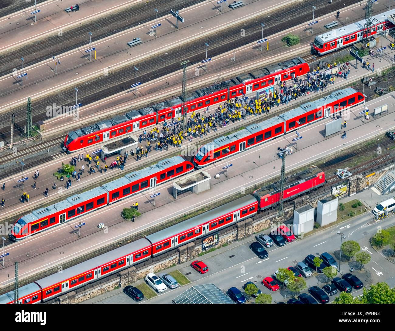 BVB fans on the S-Bahn railway, Dortmund main station, red S-Bahn, Dortmund, Ruhr area, North Rhine-Westphalia, Stock Photo