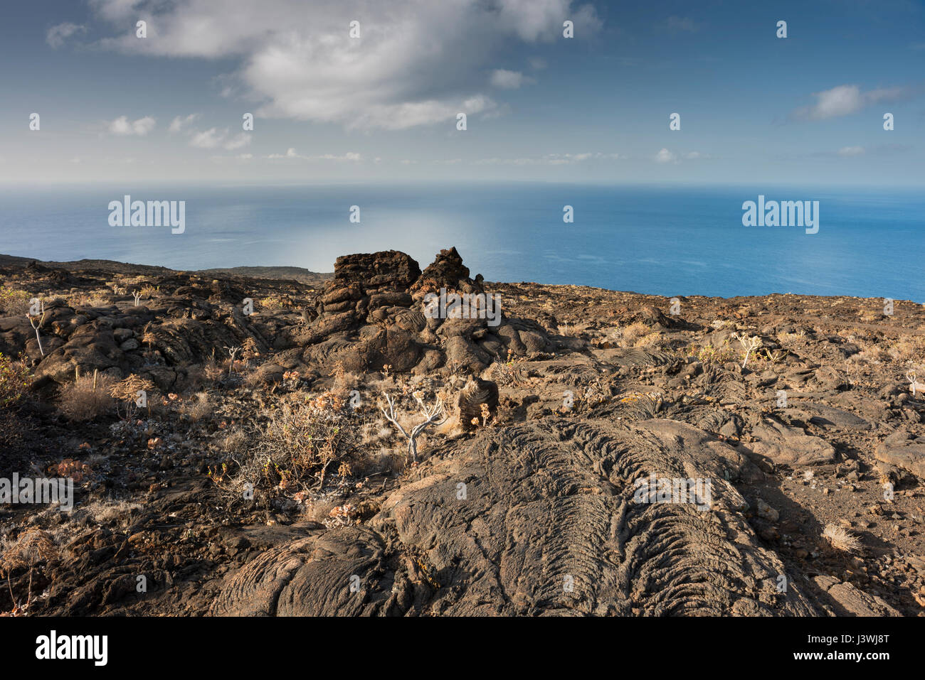 Pahoehoe or ropy basaltic lava flows at Tacoron on the south coast of El Hierro, Canary Islands, Spain - Stock Image