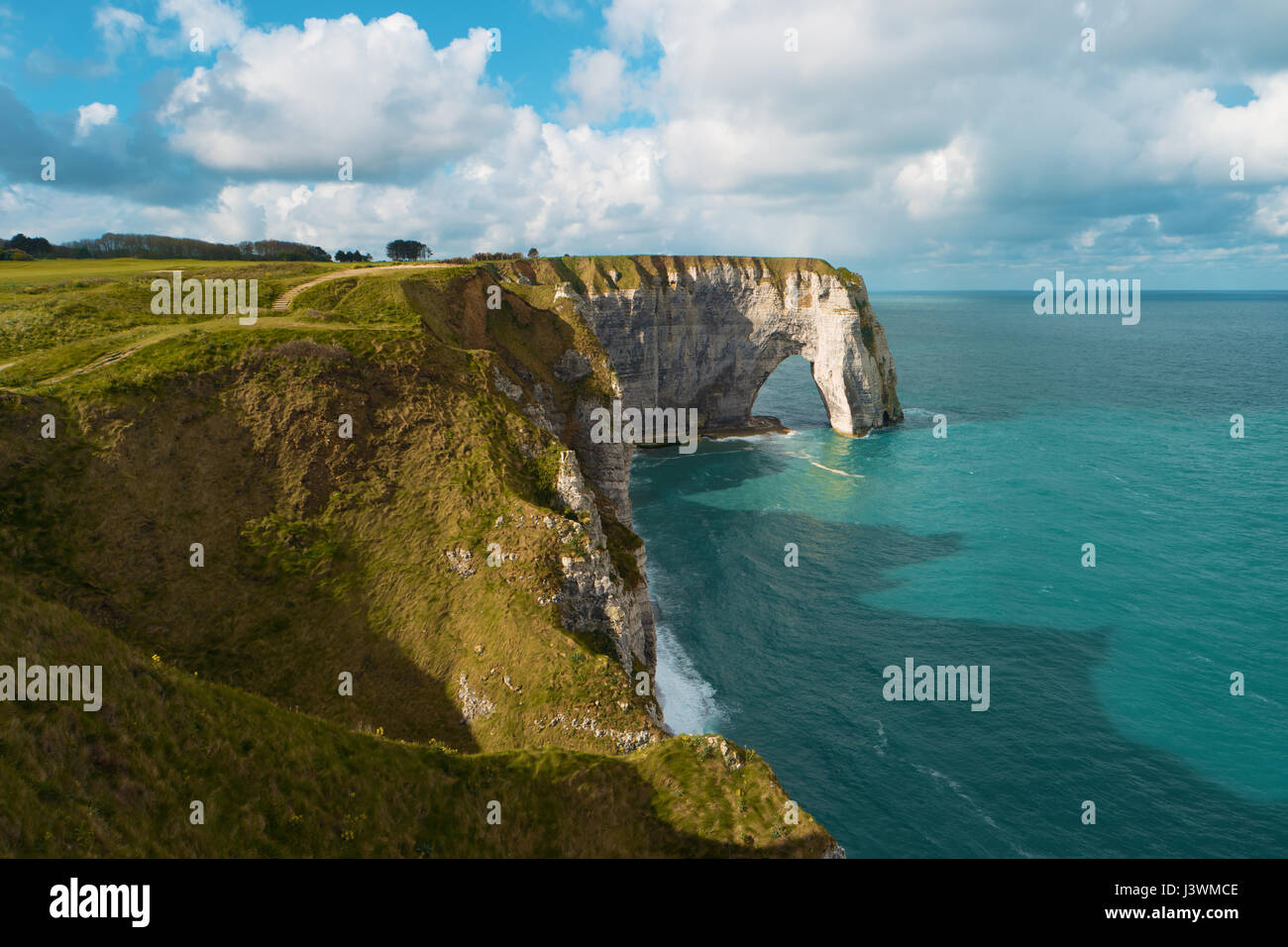Cliffs and natural arch, Etretat, France, Europe. Beautiful european landscape. Popular landmark, famous destination - Stock Image