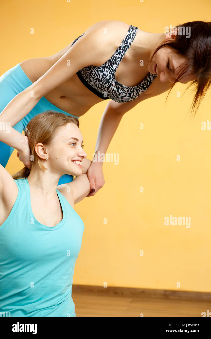 Young athletes doing stretching exercises - Stock Image