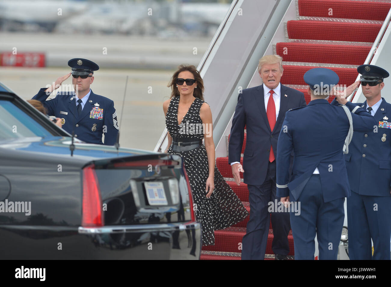 U.S. President Donald J. Trump and First Lady Melania Trump arrive on Air Force One at Palm Beach International - Stock Image