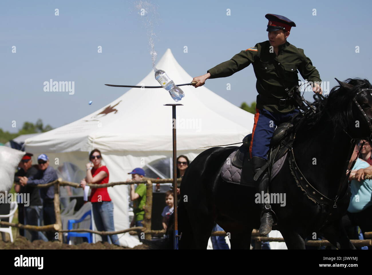 Rostov Region, Russia. 7th May, 2017. A participant sabre cuts water bottles at the Cossack national games, Shermitsii, Stock Photo