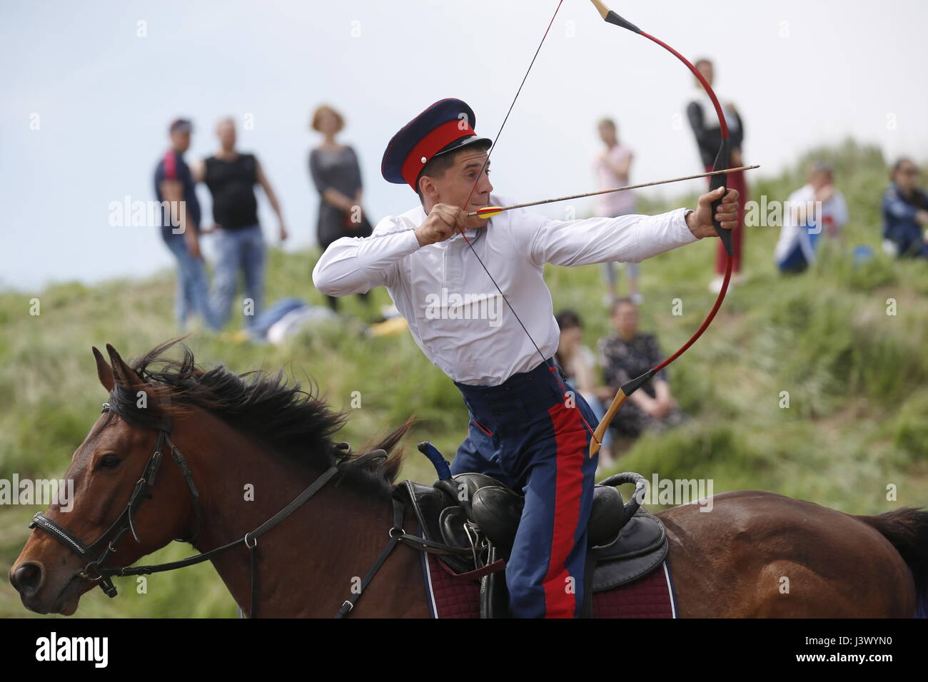 Rostov Region, Russia. 7th May, 2017. A participant in an archery contest at the Cossack national games, Shermitsii, Stock Photo