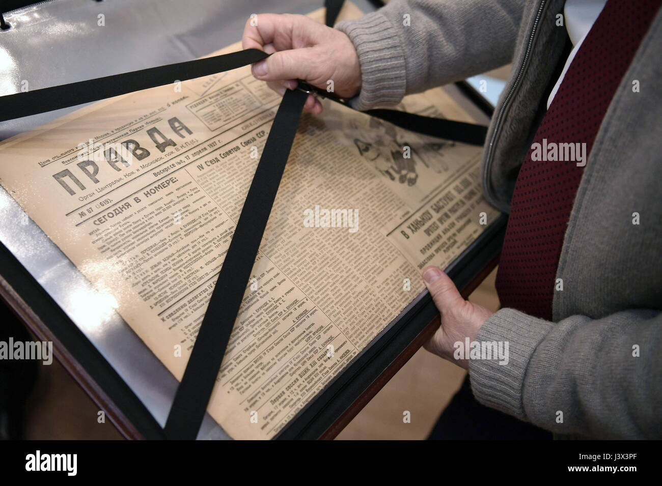 Moscow, Russia. 8th May, 2017. Russia's president Vladimir Putin with an archived edition of the Pravda newspaper - Stock Image