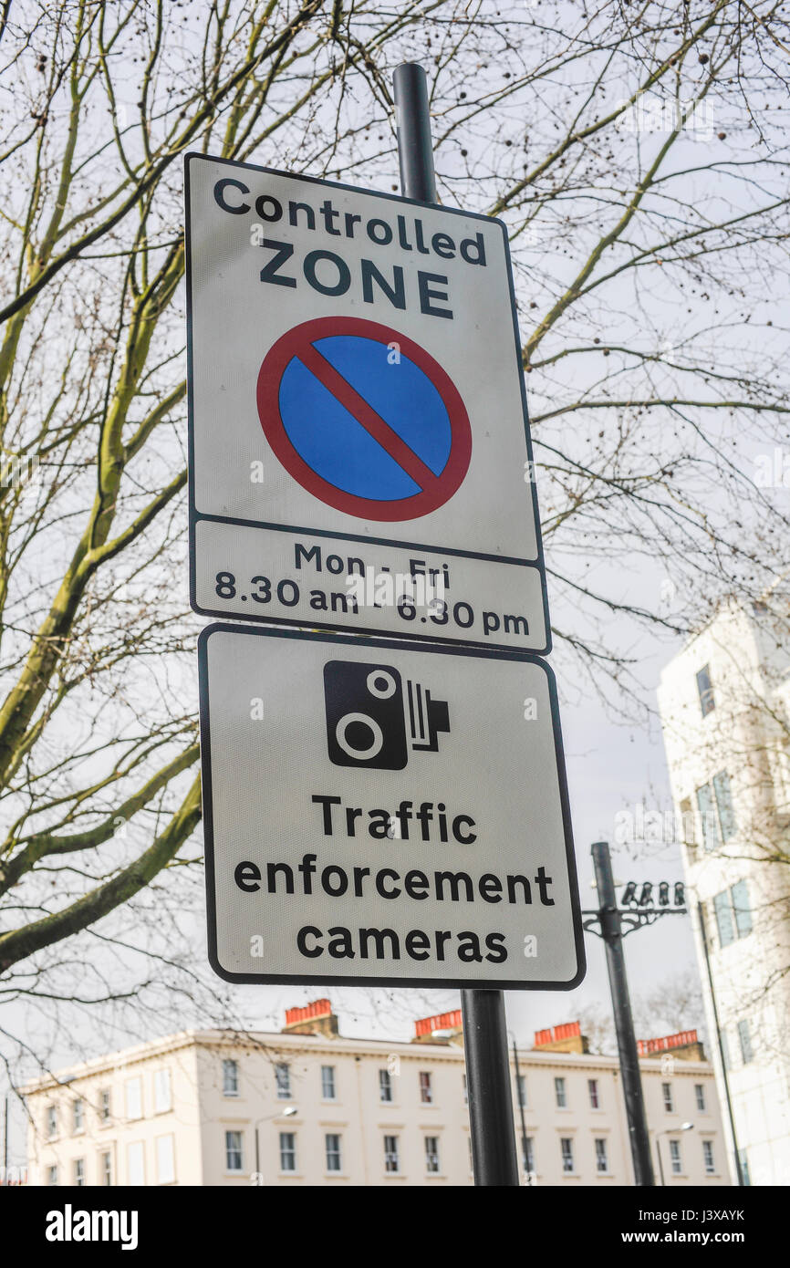 Traffic signage relating to the congestion charging system emplloyed on roads in London - Stock Image
