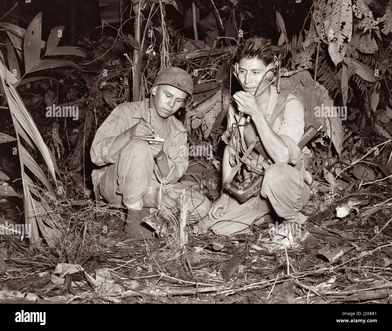 Navajo Code Talkers at Bougainville in December, 1943 during World War II. Corporal Henry Bake Jr (left) and Private - Stock Image