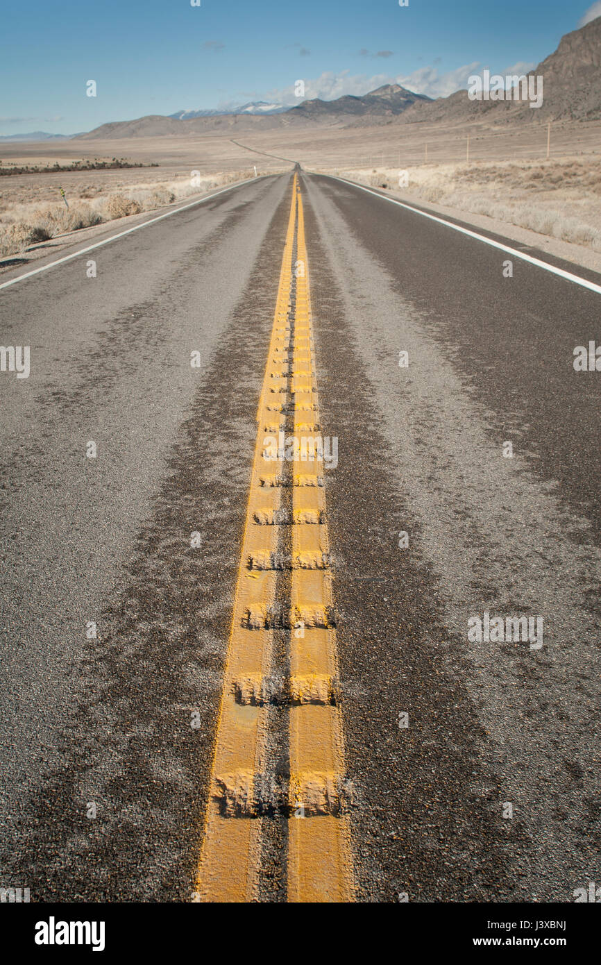 Wide open road with no vehicles. Nevada, USA. - Stock Image