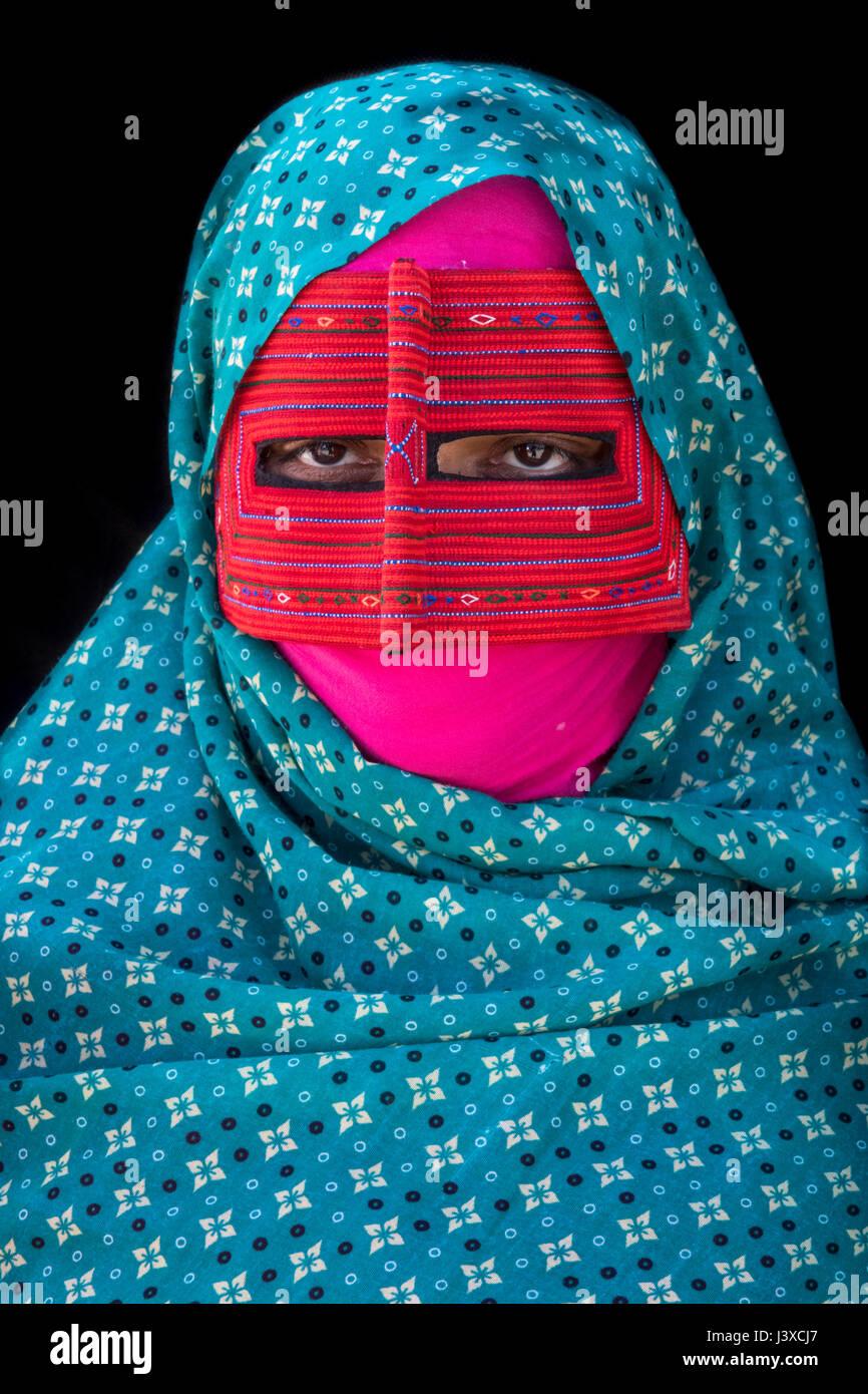 Women Wearing Burqa At Minab Weekly Market, Hormozgan Province, Iran - Portuguese settlers introduced Burqa to protect - Stock Image