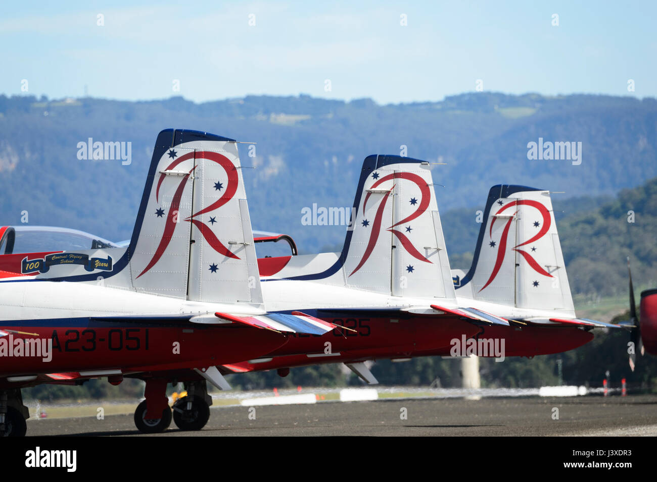 Tails of the Pilatus PC-9A A23-037 of the RAAF Roulettes Formation Aerobatic Team Aircraft at Wings over Illawarra - Stock Image