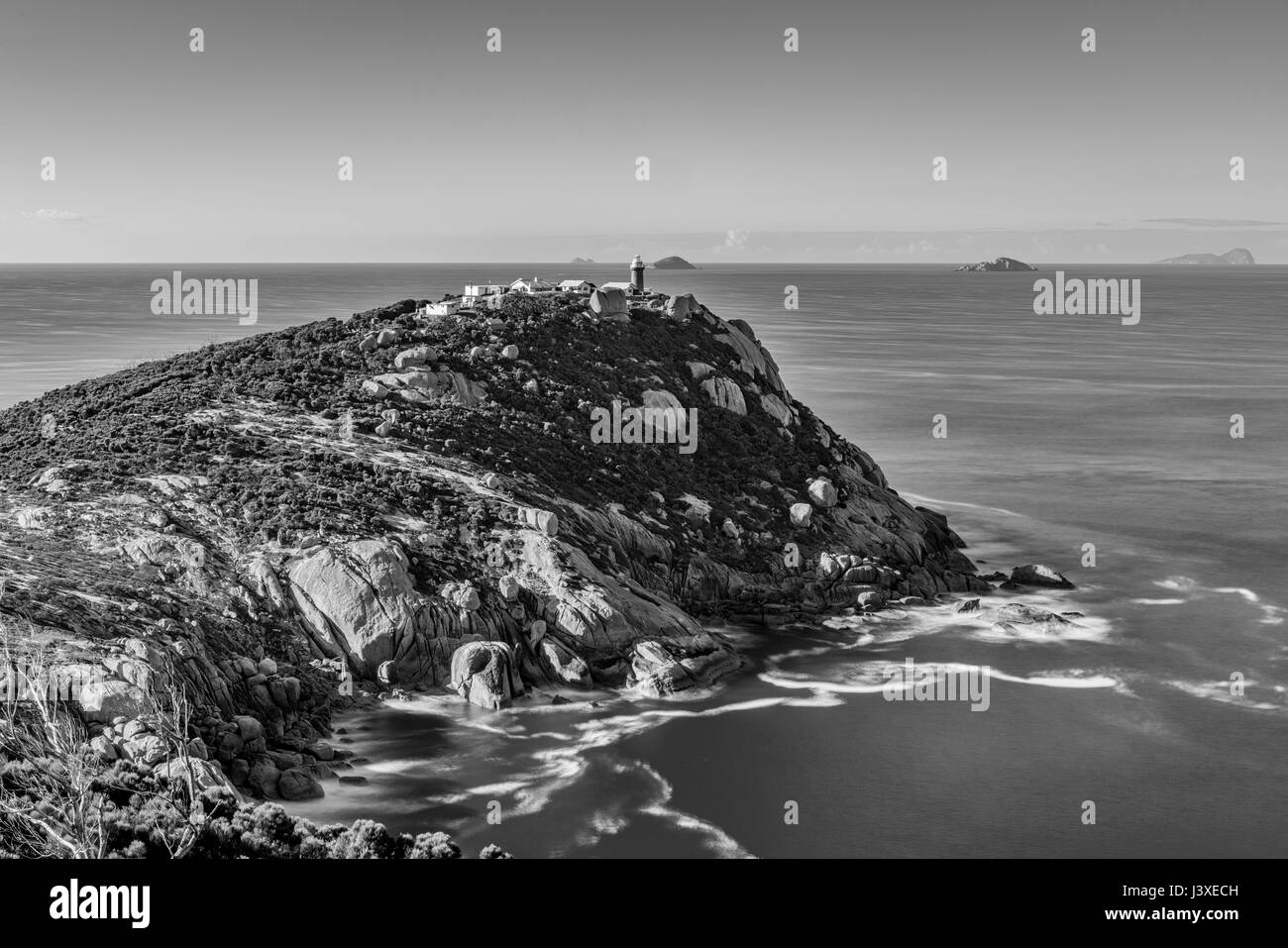 The lighthouse at Wilsons Prom during the early hours, in black and white. - Stock Image