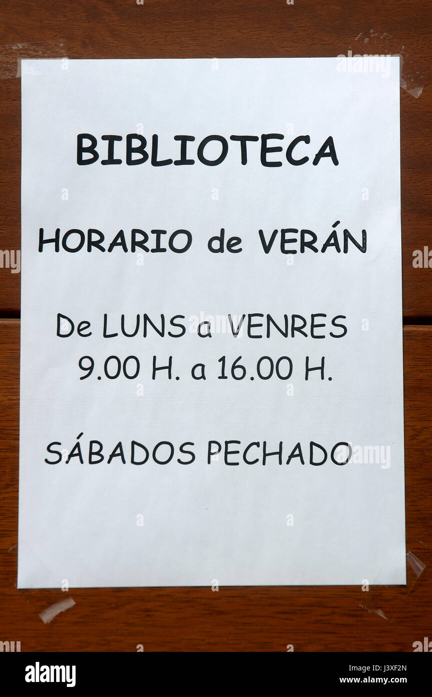 Paper sheet with library schedule in Galician language, Viveiro, Lugo province, Region of Galicia, Spain, Europe - Stock Image
