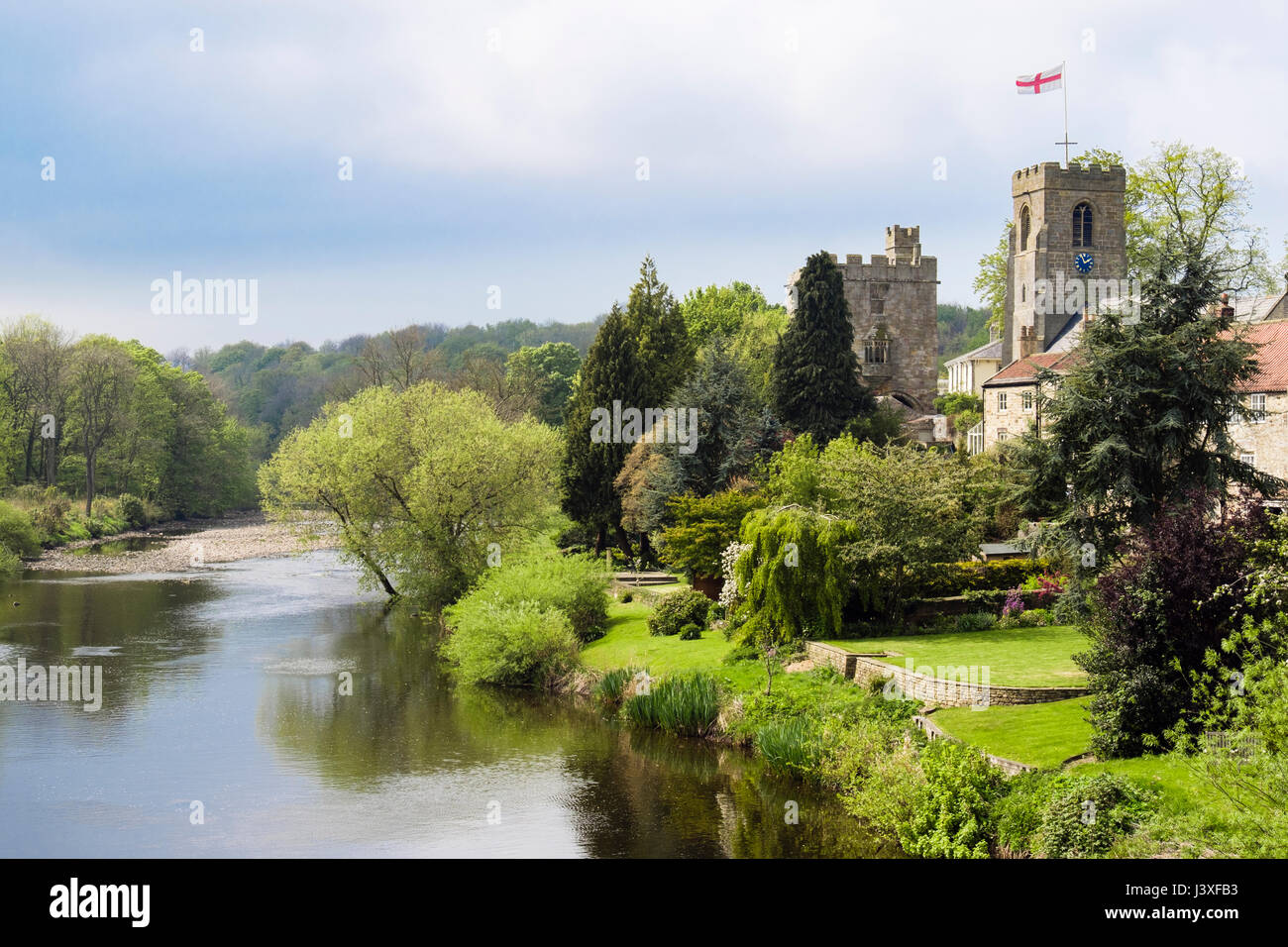 Yorkshire village church of St Nicholas and Marmion Tower beside River Ure. West Tanfield, North Yorkshire, England, - Stock Image