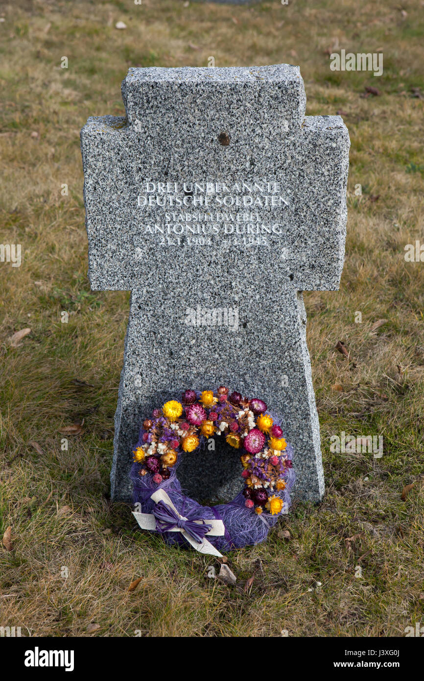 Grave of German stabsfeldwebel Antonius Düring (1903-1945) and two unknown German soldiers on the ground of - Stock Image