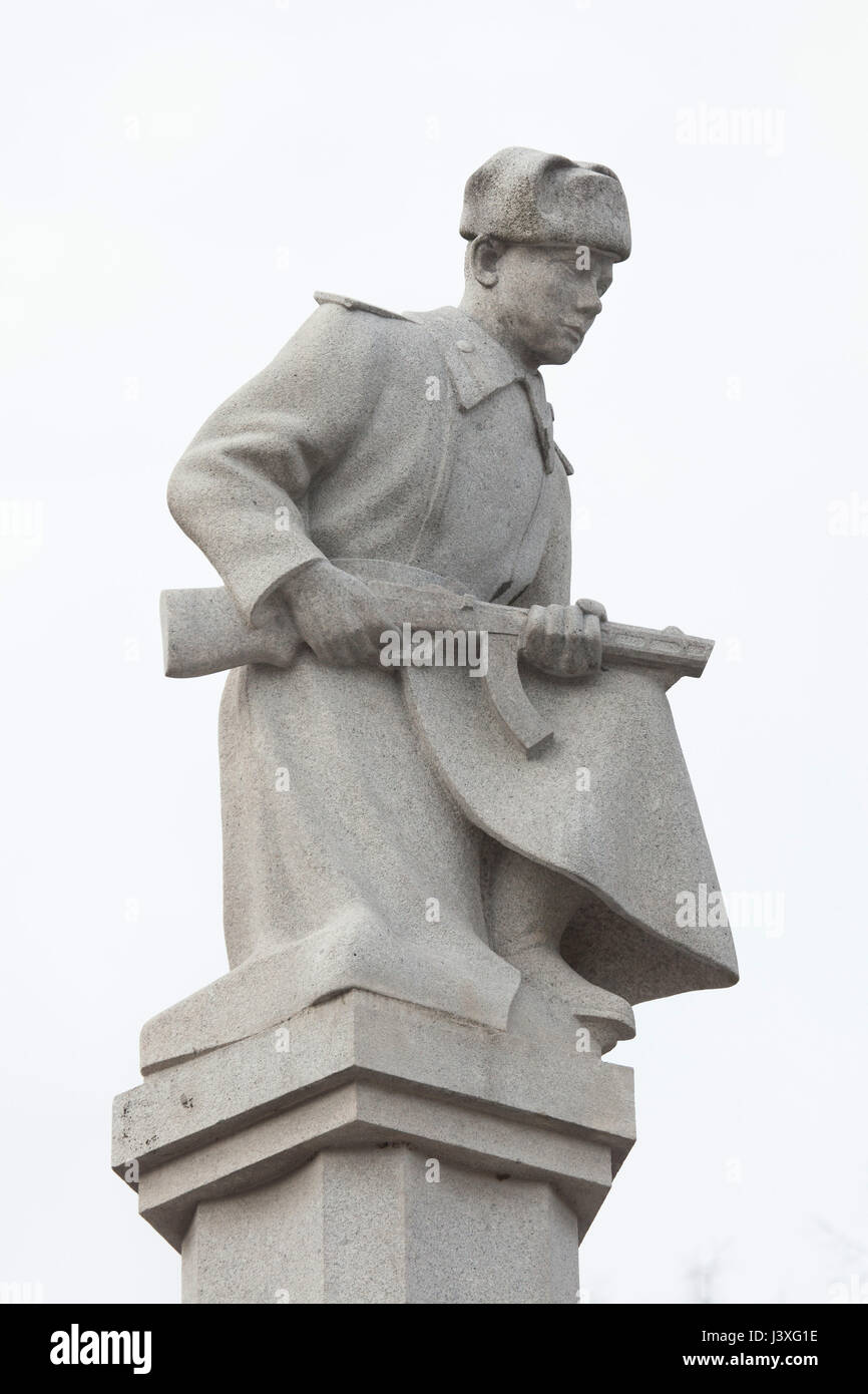 Statue of a Red Army soldier wearing winter uniform topped the Soviet War Memorial at the Central Cemetery in Brno, - Stock Image