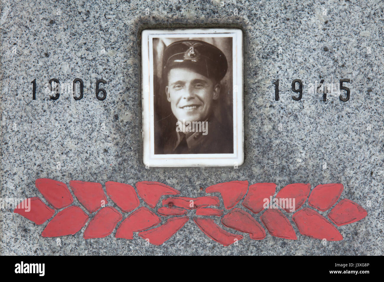 Photograph of Soviet military officer Sergey Penkin on his grave on the ground of the Soviet War Memorial at the - Stock Image