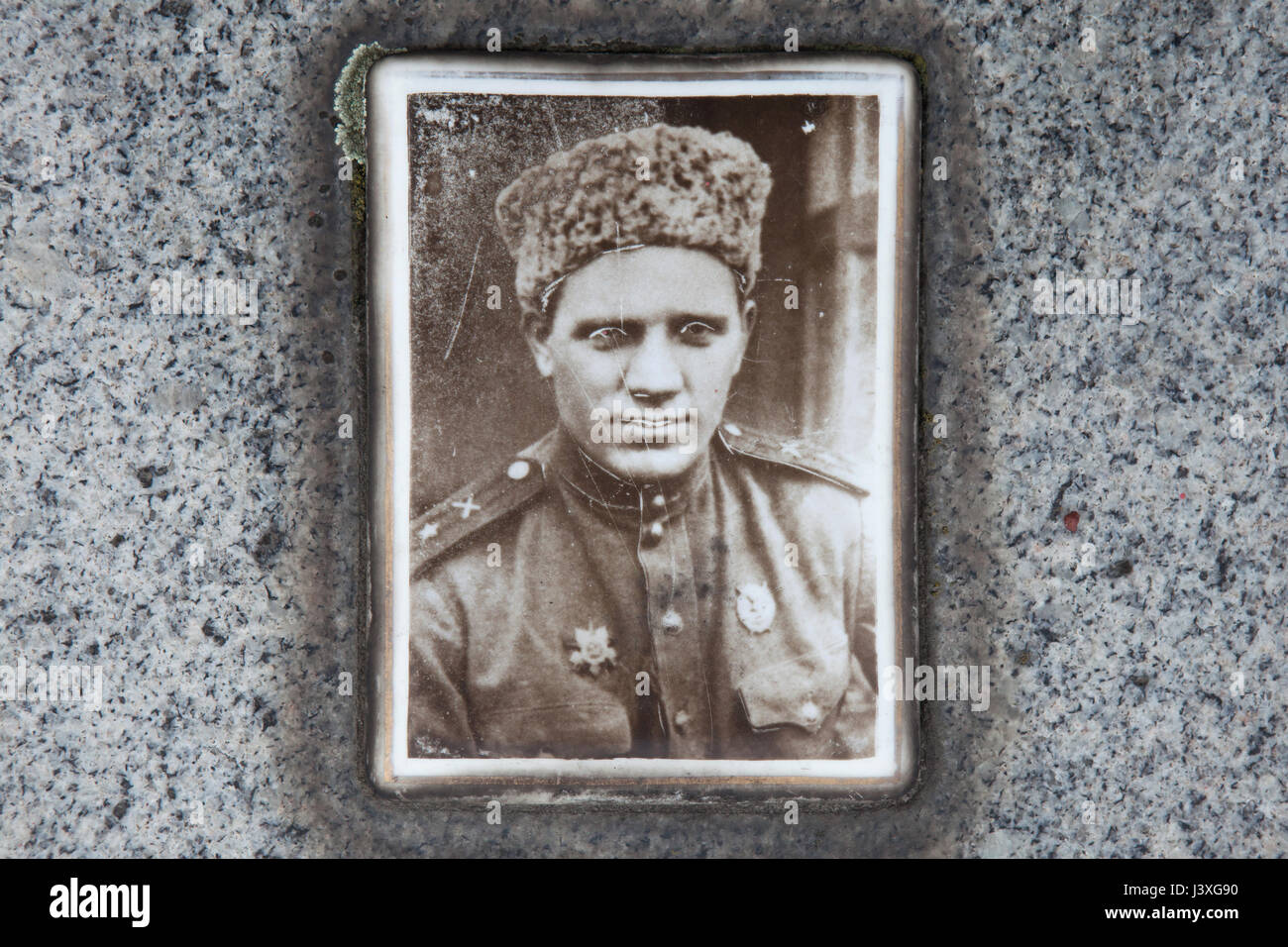 Photograph of Soviet military officer Andrey Morozov on his grave on the ground of the Soviet War Memorial at the - Stock Image