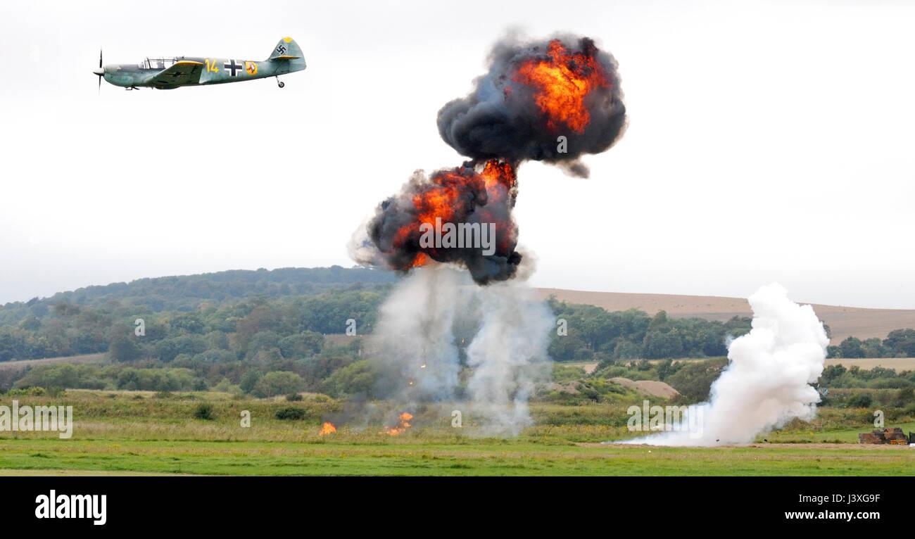 Reenactment of WW2 plane dropping bombs - Stock Image