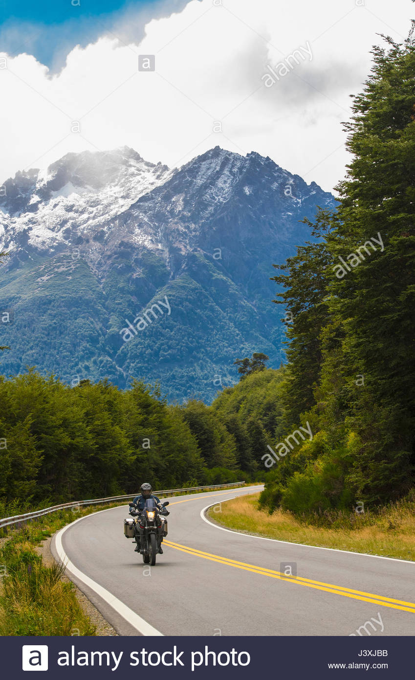 Man riding touring motorbike in the Rio Negro province of Argentina - Stock Image