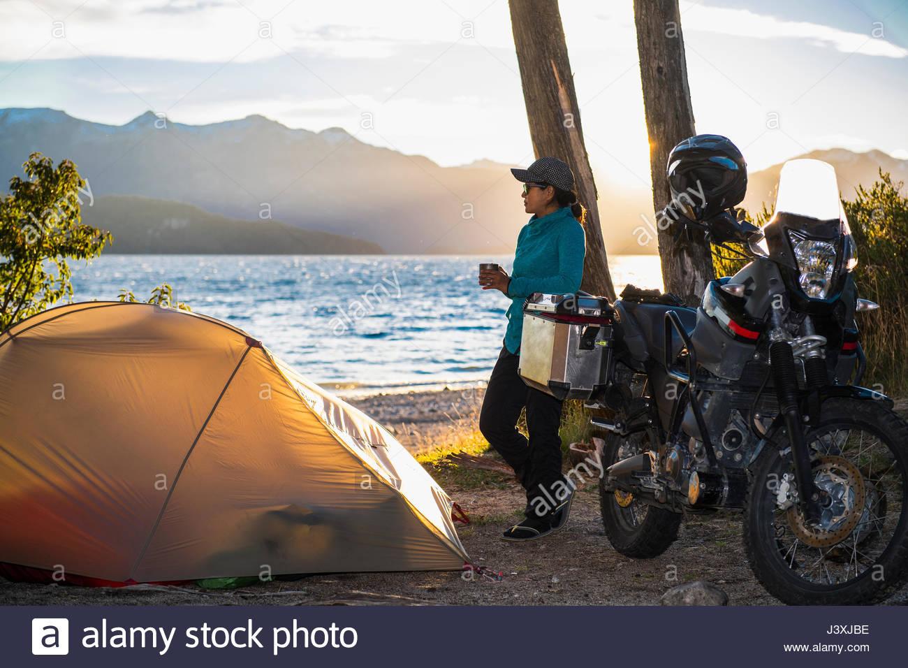 Woman relaxing at the Nahuel Huapi Lake in Patagonia - Stock Image