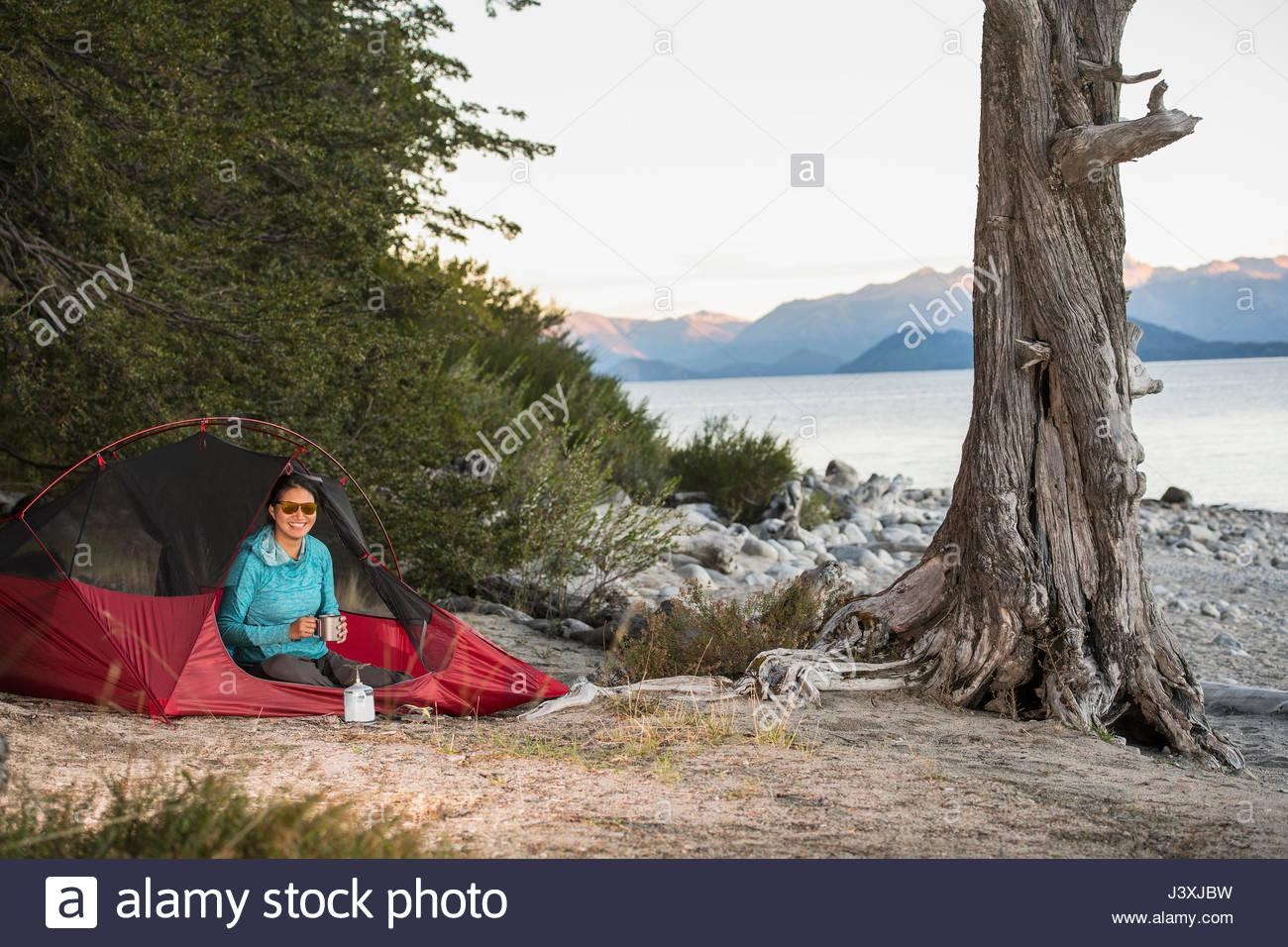 Woman camping at Nahuel Huapi Lake in Patagonia - Stock Image