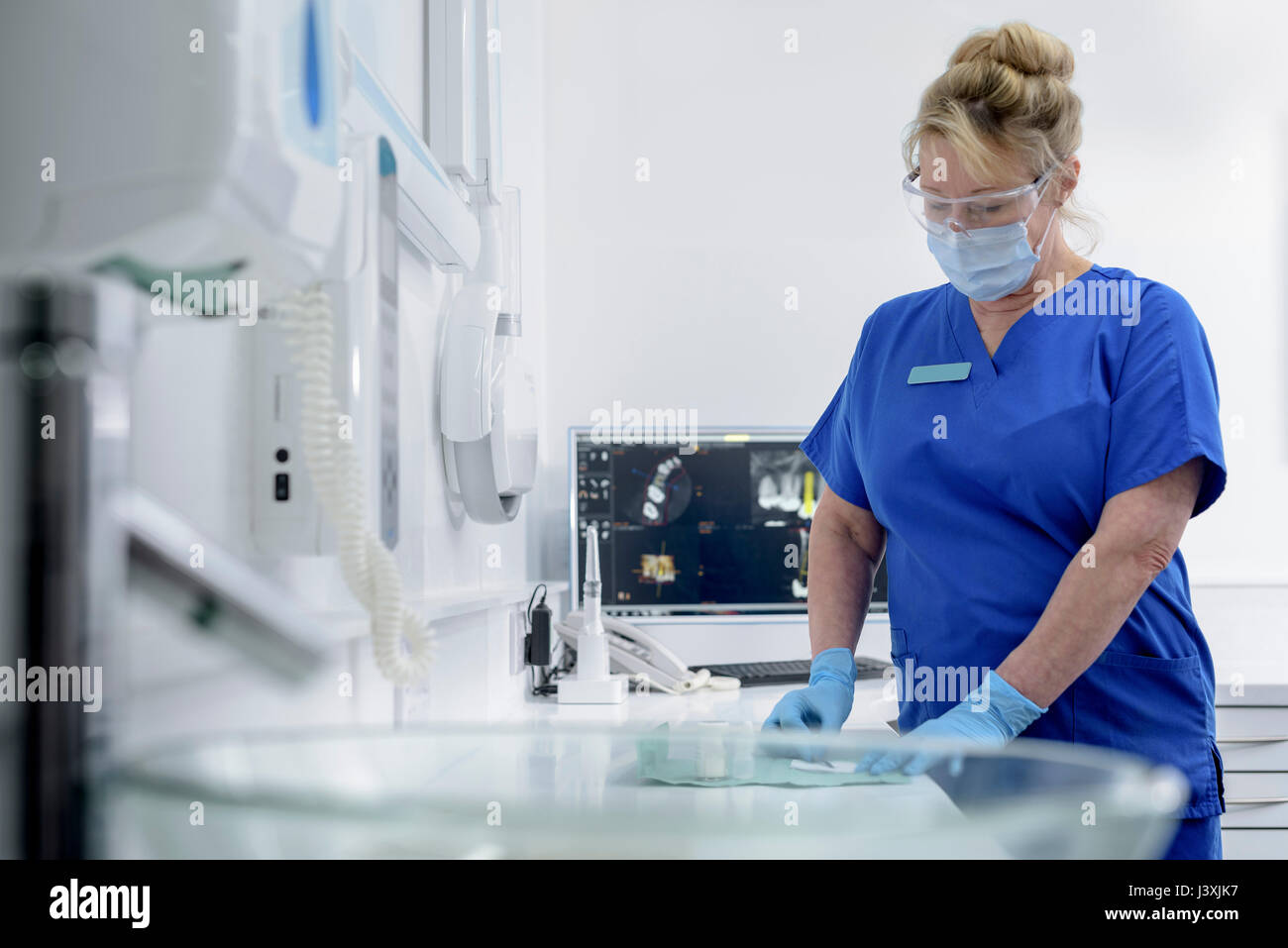 Assistant nurse in dental surgery - Stock Image