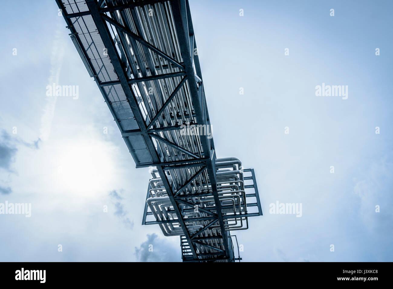 Pipes viewed from below in oil blending plant, Antwerp, Belgium, Europe - Stock Image