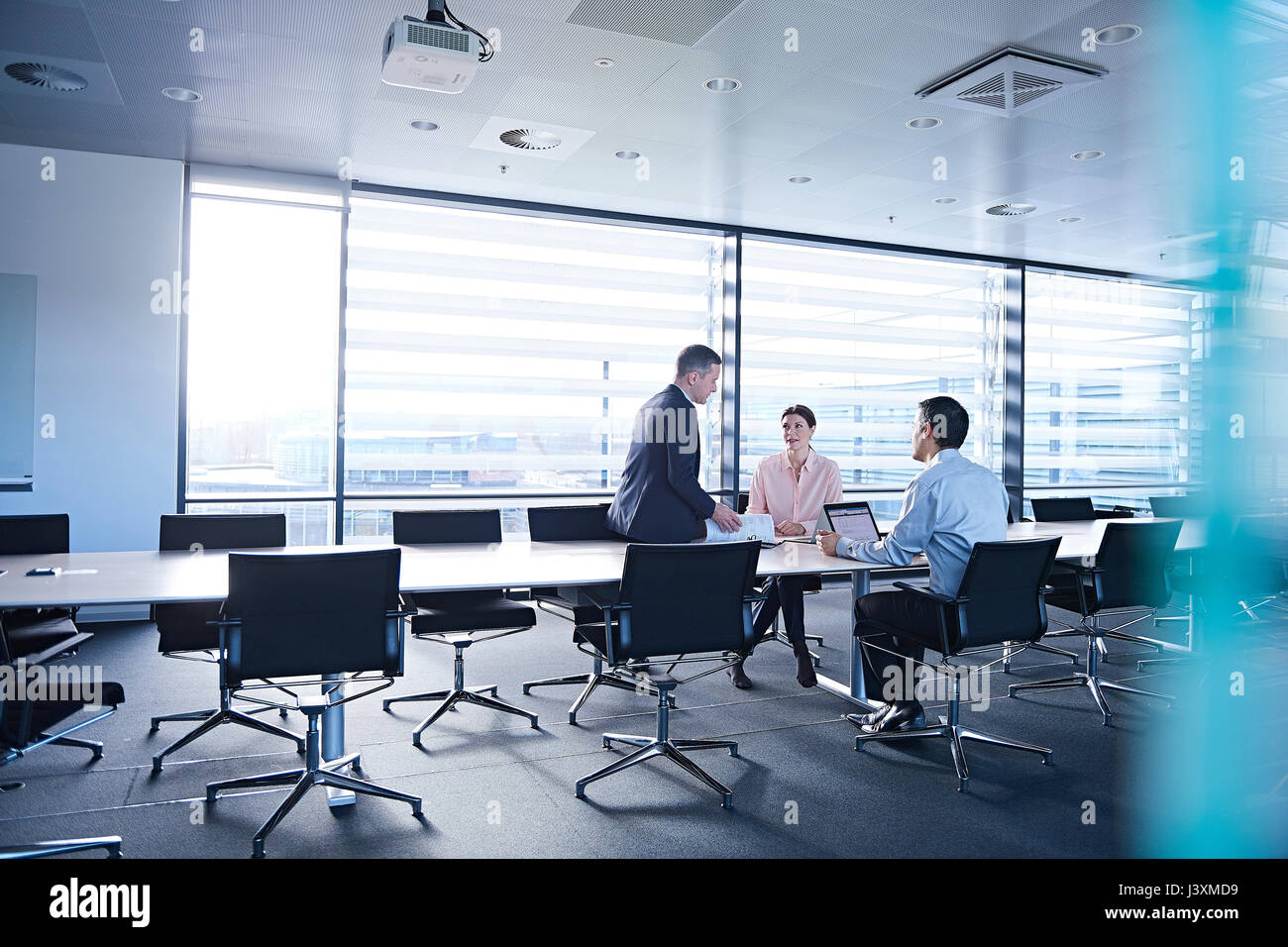 Business team meeting at boardroom table - Stock Image