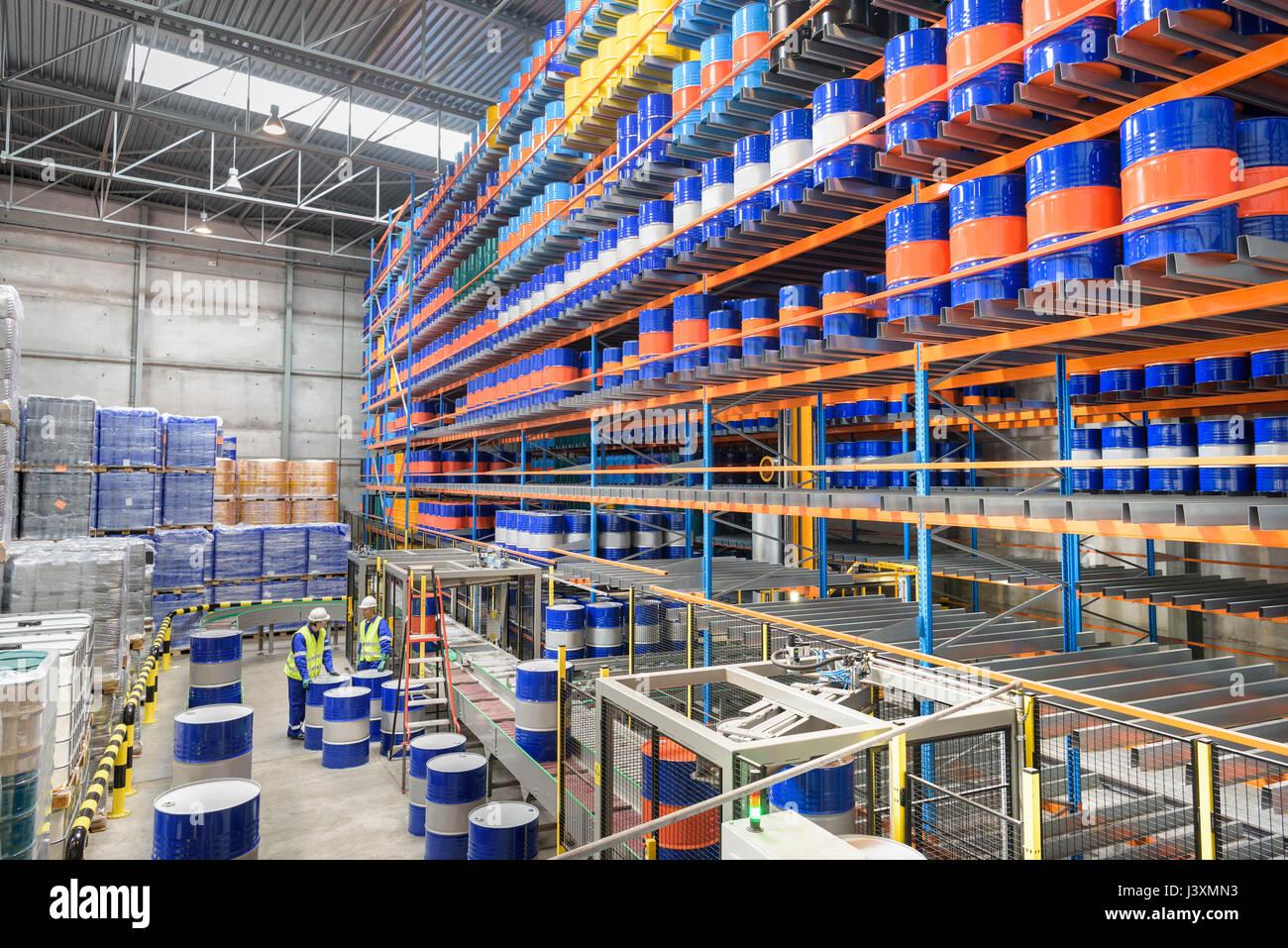 Oil barrels in robotic storage in oil blending factory - Stock Image