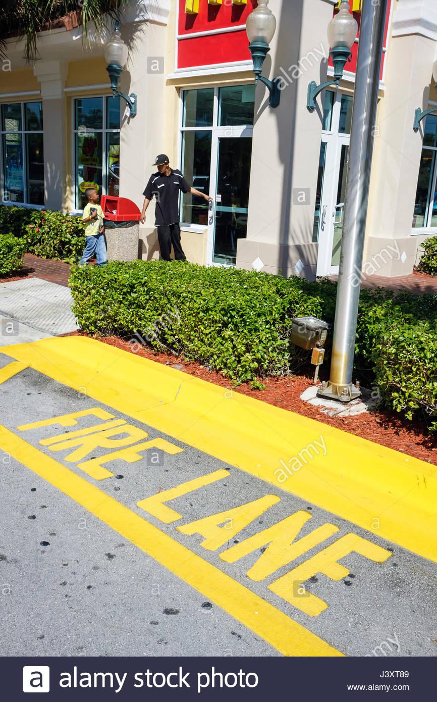 Florida Miramar McDonald's Restaurant fire lane sidewalk marking yellow curb emergency access - Stock Image