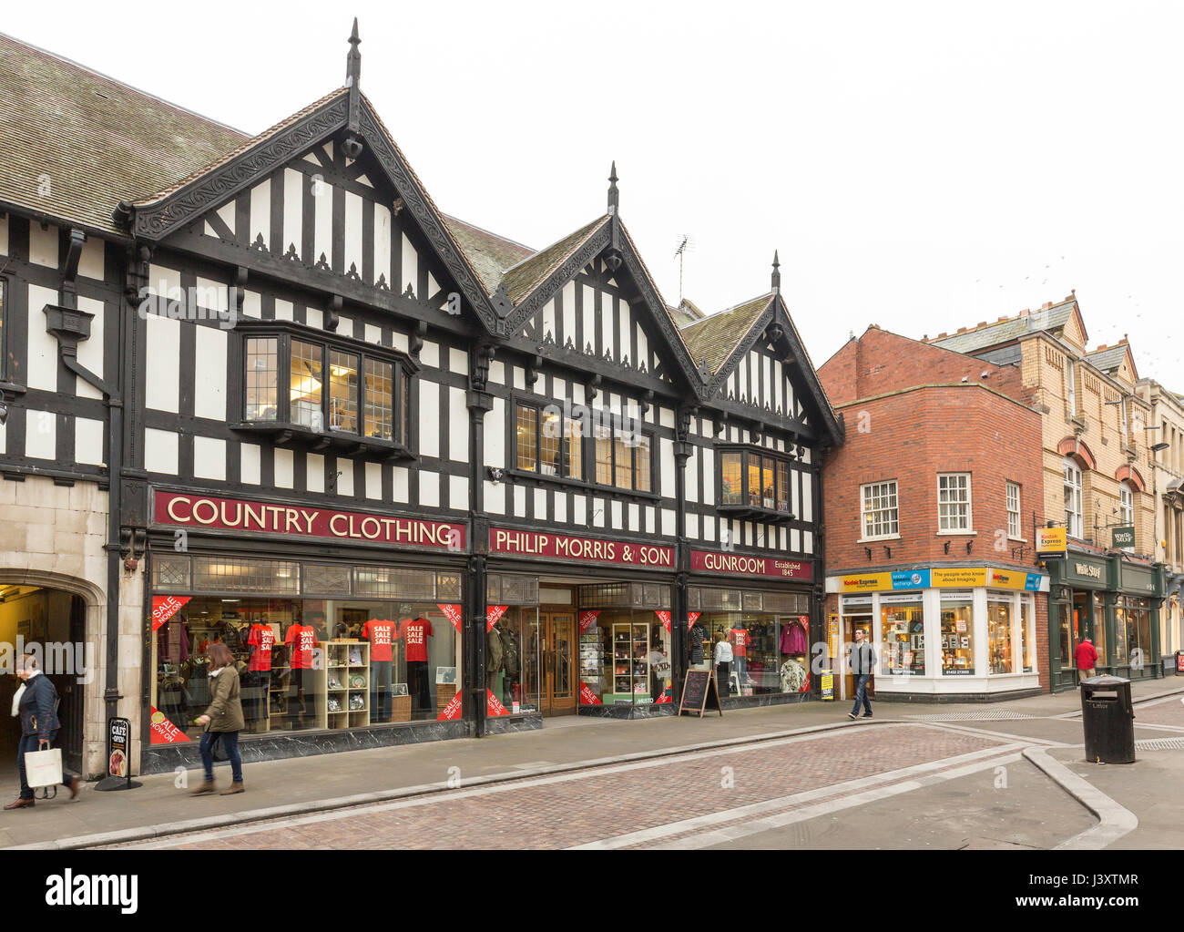 Shopping street with timbered buildings, Hereford, England, UK - Stock Image