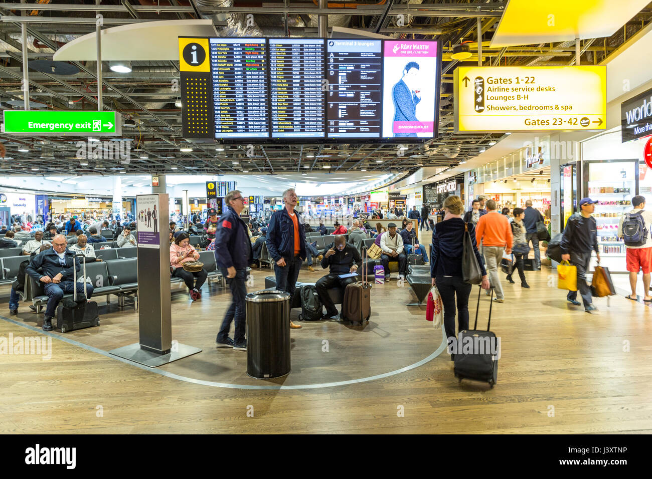 Travellers at Heathrow airport, London, UK - Stock Image