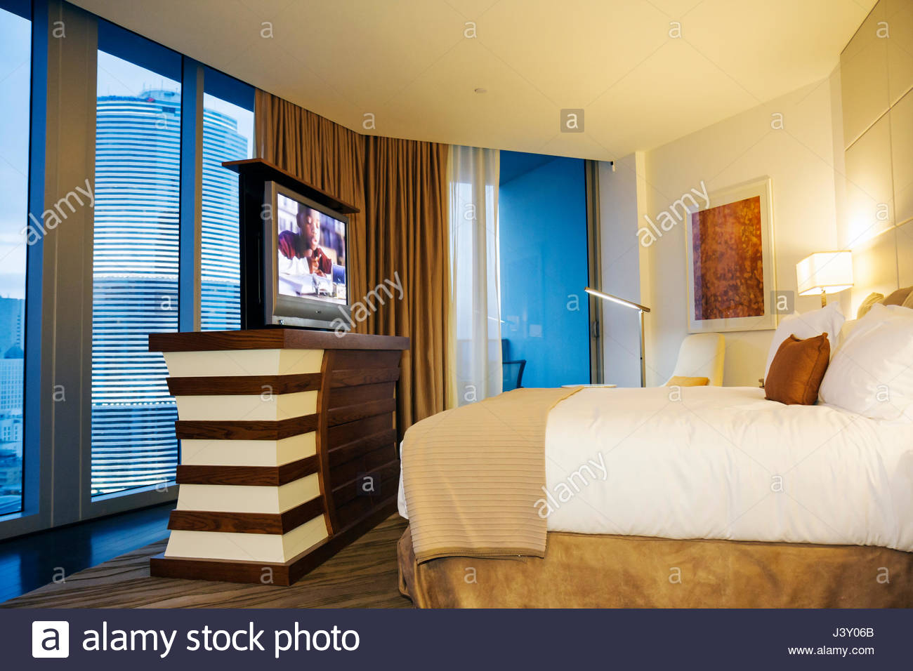 miami florida epic hotel luxury boutique lodging hospitality guest room bed lamps side tables flat screen tv modern decor