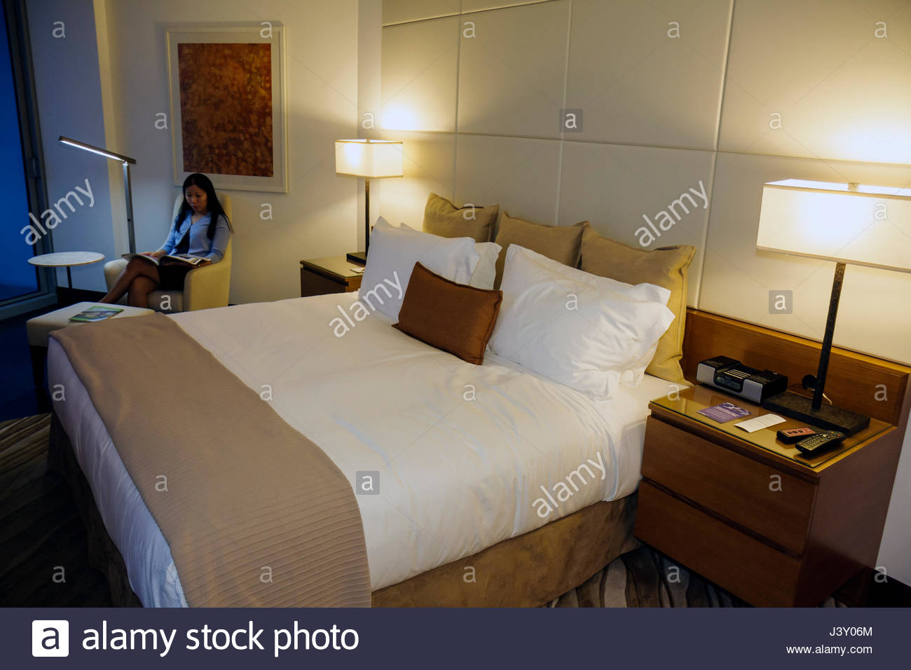 miami florida epic hotel luxury boutique lodging hospitality guest room bed lamps side tables flat screen tv modern decor asian