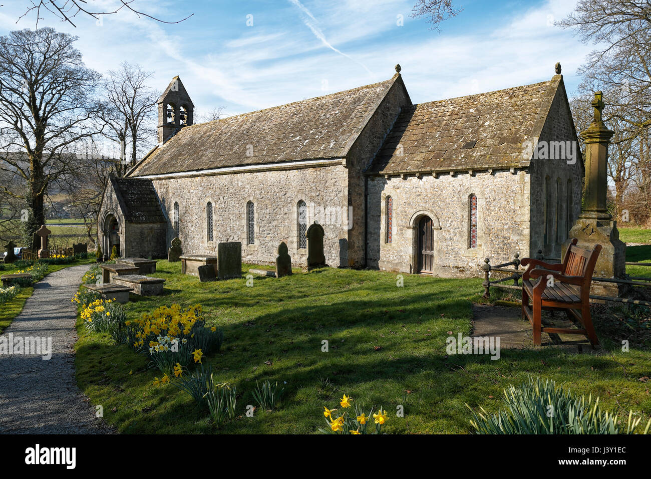 Conistone village St. Marys church North Yorkshire in springtime with daffodils blooming. Stock Photo