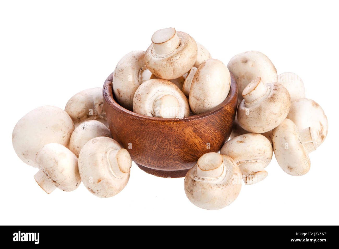Mushroom champignon in wooden bowl isolated on white background Stock Photo