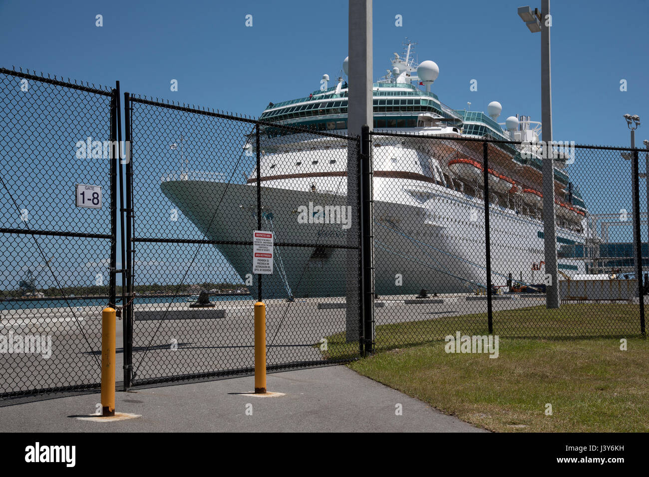 Security fence around a cruise ship on the quay at Port Canaveral Florida USA. April 2017. - Stock Image