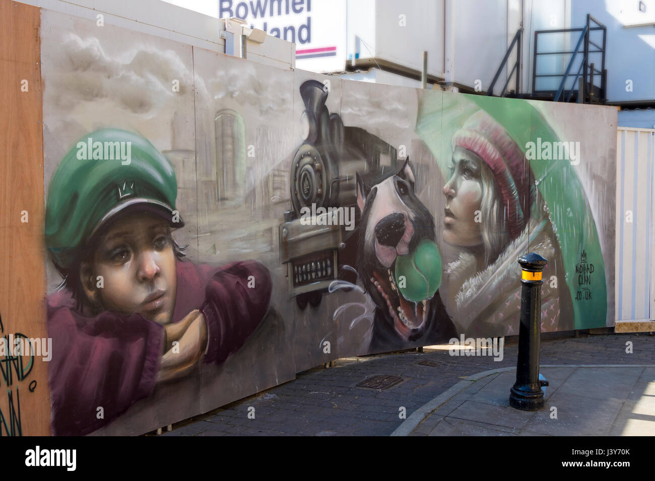 Wall mural by Nomad Clan on hoardings at the Hotel Indigo building site, Corporation Street, Manchester, England, - Stock Image