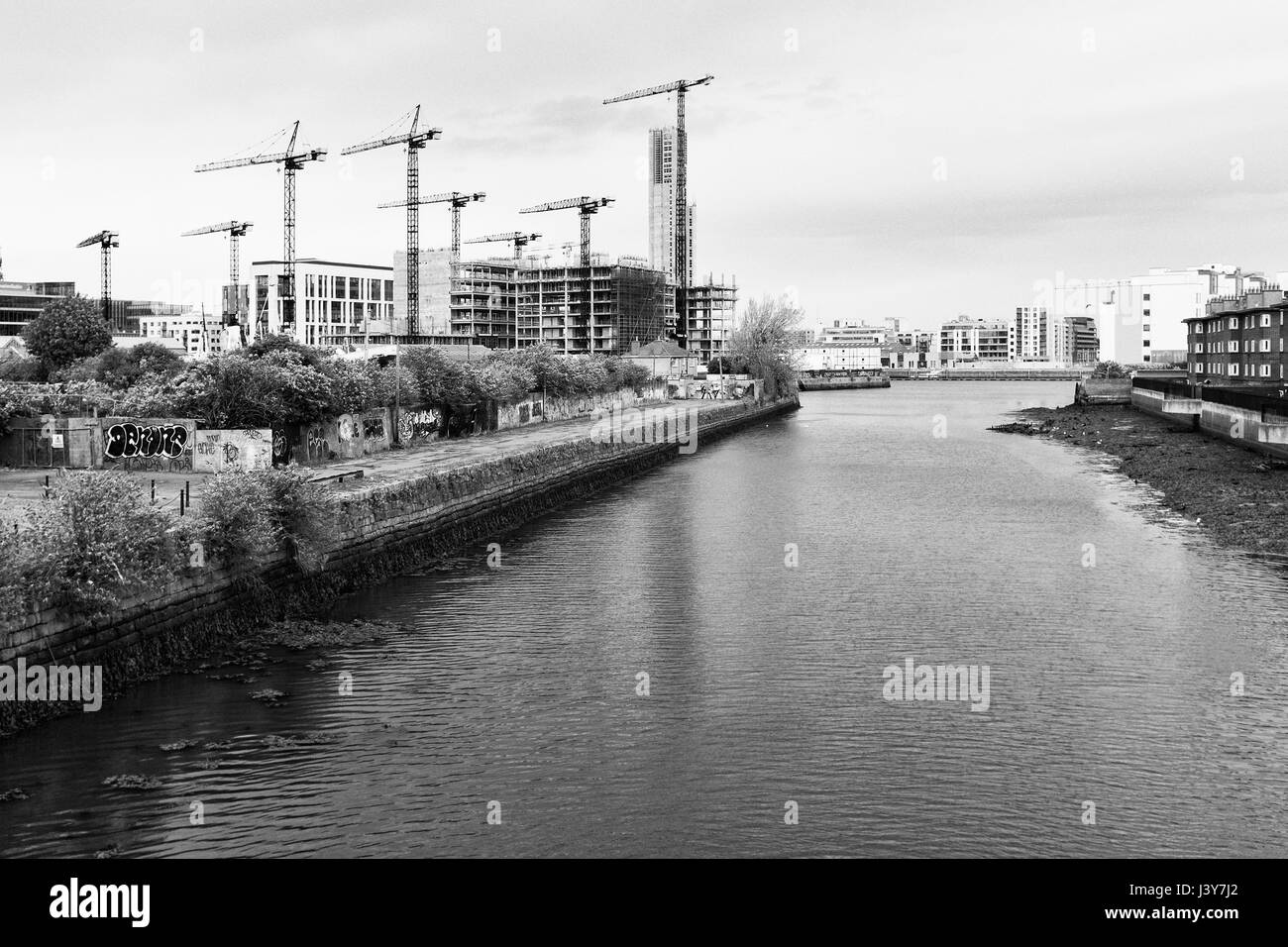 Construction in Dublin by Liffey river, black and white photography - Stock Image